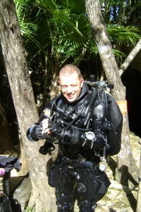 Russell coming out of the water at cenote Xtabay.